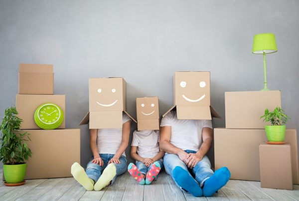 a family surround by moving boxes
